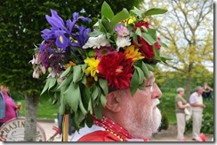 Man with bouquet on head